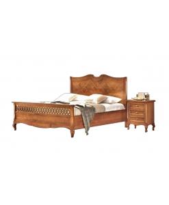 Letto in legno con intarsio