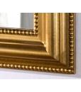 Dettaglio angolo specchiera in foglia oro